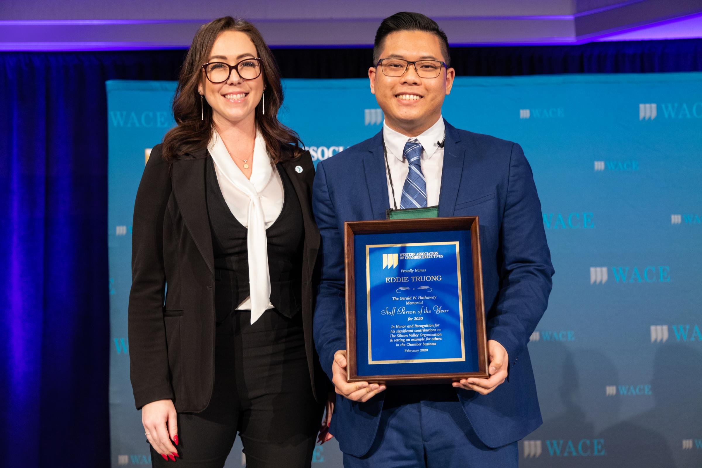 Jessica Welch (left), vice president of operations, Greater Irvine Chamber, presents Eddie Truong (right) the 2020 W.A.C.E. Staff Person of the Year Award.